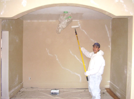Richard Ancheta painting walls for interior painting decoration.